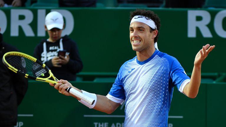 Italy's Marco Cecchinato celebrates his win against Stan Wawrinka