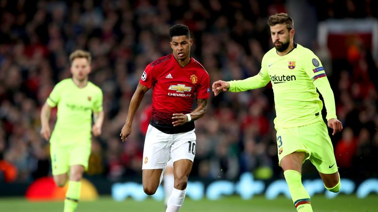 Manchester United forward Marcus Rashford battles for possession with Barcelona's Gerard Pique