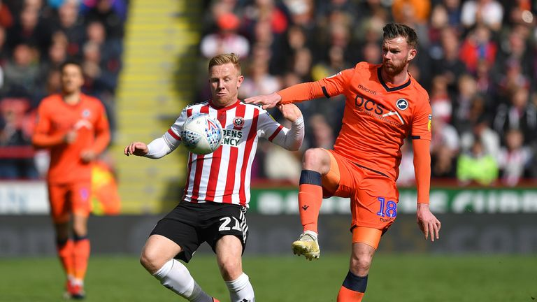 Sheffield United's Mark Duffy battles with Millwall's Ryan Tunnicliffe