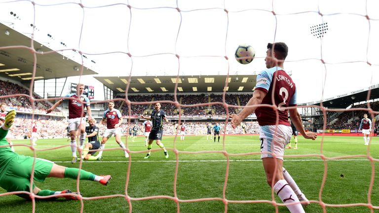 Matt Lowton's control took the ball barely three centimetres over the line from Sergio Aguero's shot