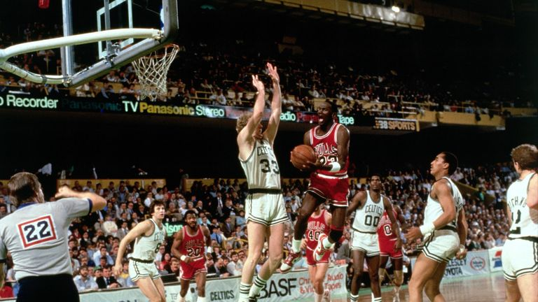 Michael Jordan of the Chicago Bulls drives to the basket against Larry Bird of the Boston Celtics during Game 2 of the Eastern Conference quarterfinals during the 1986 NBA Playoffs on April 20, 1986