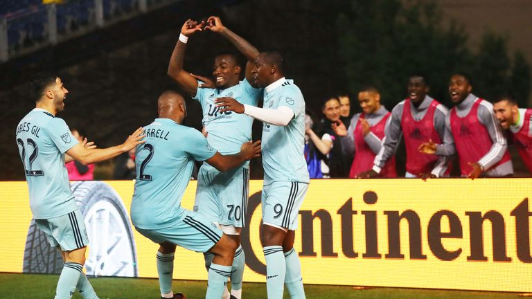 New England Revolution's Cristian Penilla celebrates with team-mates after scoring against the New York Red Bulls
