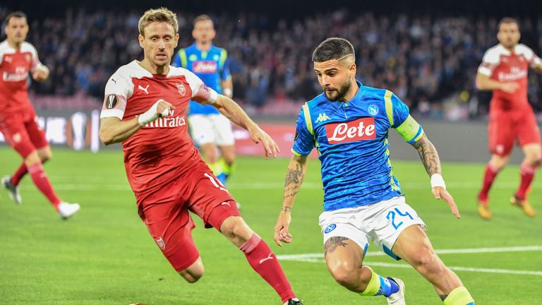 Napoli's Italian forward Lorenzo Insigne (R) outruns Arsenal's Spanish defender Nacho Monreal (L) during the UEFA Europa League quarter-final second leg football match Napoli vs Arsenal on April 18, 2019 at the San Paolo stadium in Naples. (Photo by Andreas SOLARO / AFP) (Photo credit should read ANDREAS SOLARO/AFP/Getty Images)