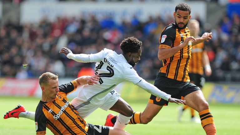Nathan Dyer of Swansea City is tackled by Stephen Kingsley of Hull City