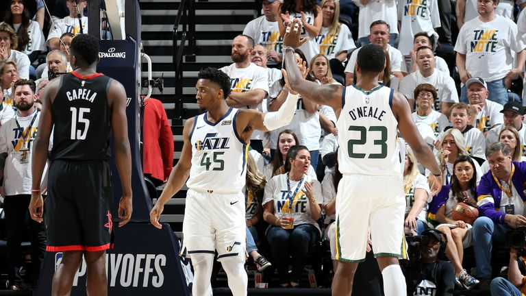 Donovan Mitchell  and Royce O'Neale of the Utah Jazz high five during Game Four of Round One of the 2019 NBA Playoffs against the Houston Rockets