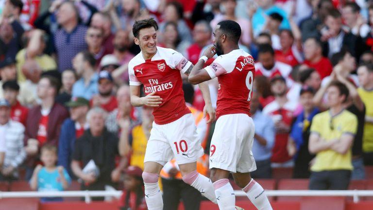 Mesut Ozil and Alexandre Lacazette celebrate following Ozil's equaliser against Crystal Palace.