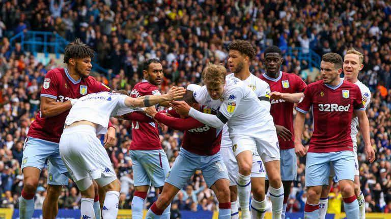 Leeds' Patrick Bamford grapples with Villa's Conor Hourihane during chaotic scenes at Elland Road