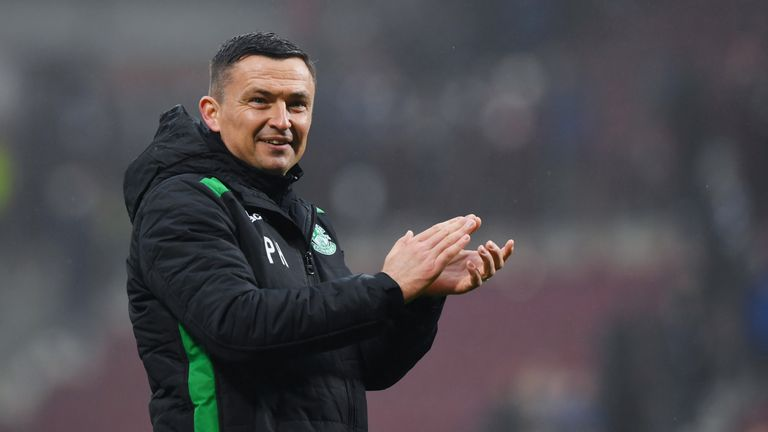 Hibernian manager Paul Heckingbottom applauds the fans at full time