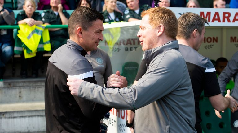Hibernian manager Paul Heckingbottom shakes hands with Celtic manager Neil Lennon