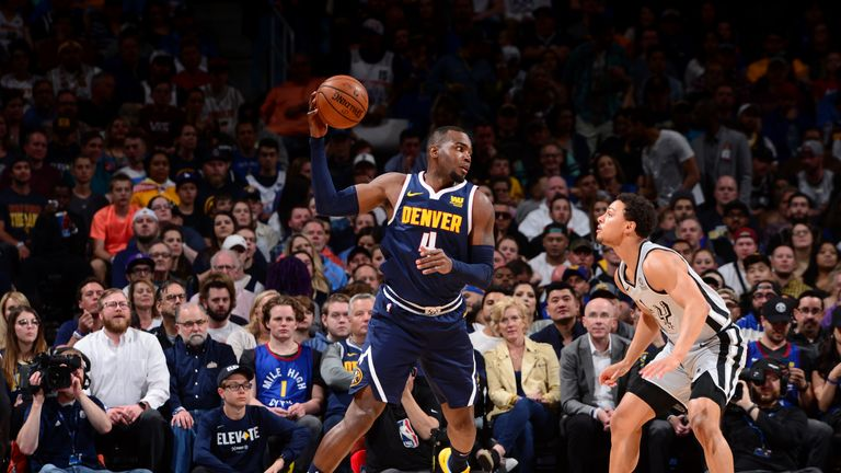 DENVER, CO - APRIL 27: Paul Millsap #4 of the Denver Nuggets handles the ball against the San Antonio Spurs during Game Seven of Round One of the 2019 NBA Playoffs on April 27, 2019 at the Pepsi Center in Denver, Colorado.