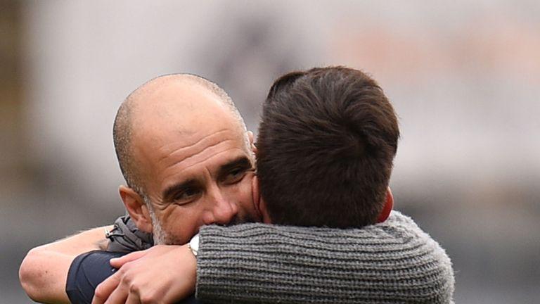 City boss Pep Guardiola hugs David Silva after the win