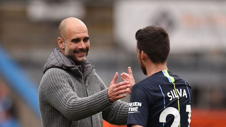 Pep Guardiola celebrates with David Silva following his side's 1-0 over Burnley at Turf Moor