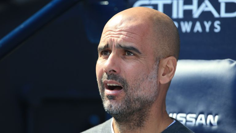 Pep Guardiola looks on during Manchester City's win over Tottenham