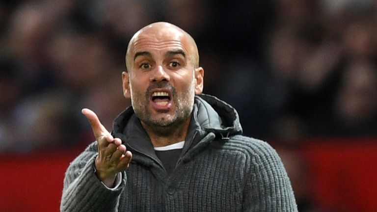 Pep Guardiola reacts on the touchline at Old Trafford