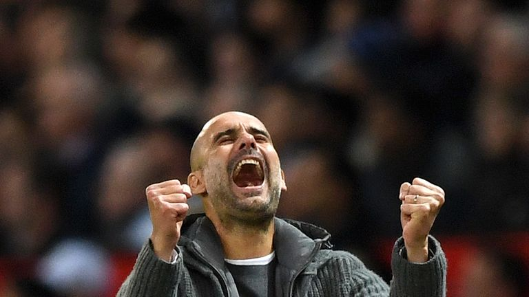 Guardiola pumps his fists in celebration after Leroy Sane put City 2-0 up at Old Trafford