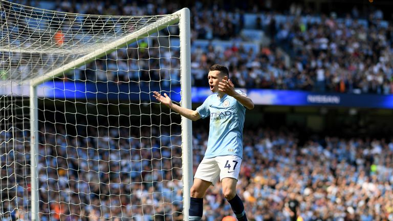 Phil Foden celebrates his early goal for Man City