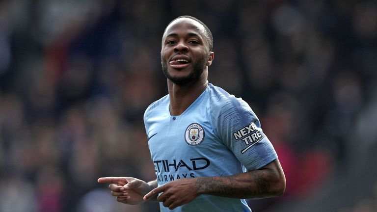 Raheem Sterling celebrates scoring Manchester City's second against Crystal Palace