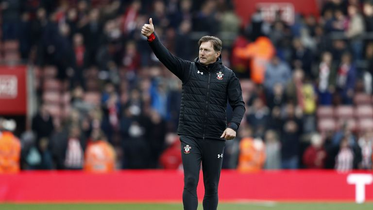 Southampton's Austrian manager Ralph Hasenhuttl gestures to supporters on the pitch after the English Premier League football match between Southampton and Wolverhampton Wanderers at St Mary's Stadium in Southampton, southern England on April 13, 2019.