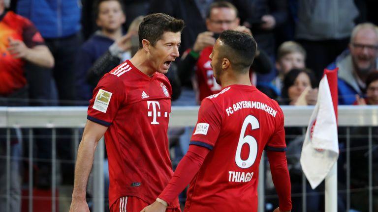 Robert Lewandowski celebrates his 200th Bundesliga goal