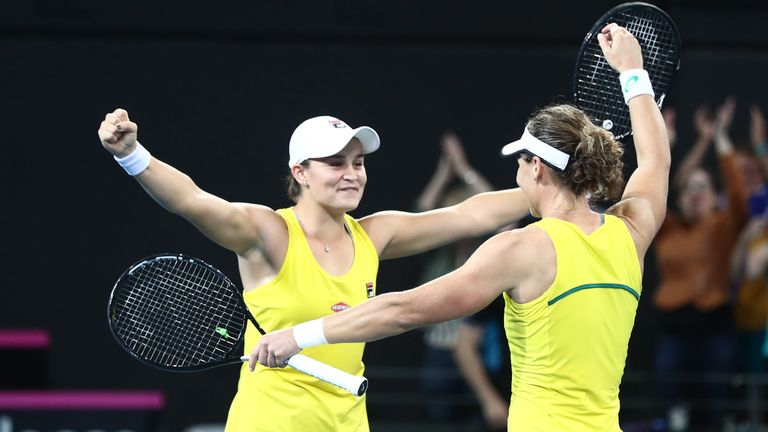 Ashleigh Barty and Sam Stosur celebrate Australia winning their crucial doubles rubber to reach the Fed Cup final