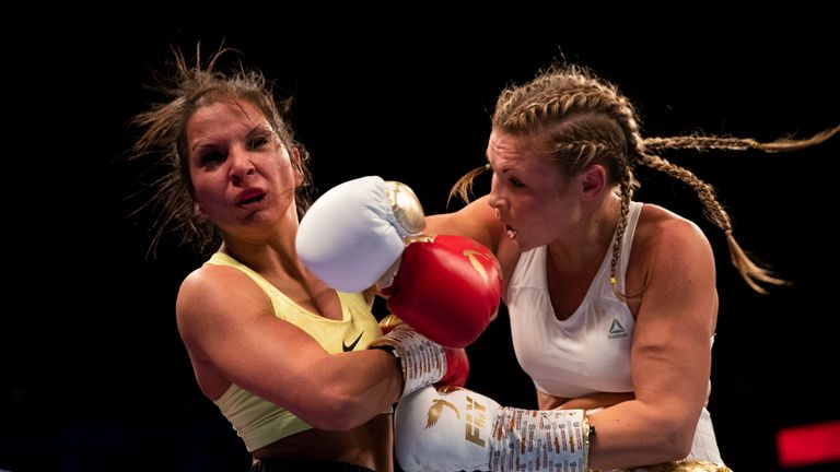 Shannon Courtenay lands a right hook during her bantamweight clash