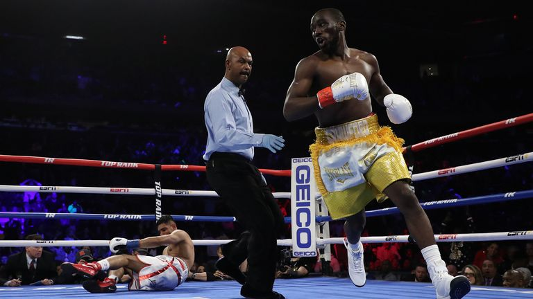 Amir Khan is sent to the canvas by WBO welterweight champion Terence Crawford