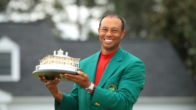 Tiger Woods pulled on his fifth green jacket at Augusta