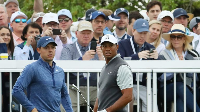 AUSTIN, TEXAS - MARCH 30: Tiger Woods of the United States and Rory McIlroy of Northern Ireland look on from the seventh tee during the fourth round of the World Golf Championships-Dell Technologies Match Play at Austin Country Club on March 30, 2019 in Austin, Texas. (Photo by Warren Little/Getty Images)