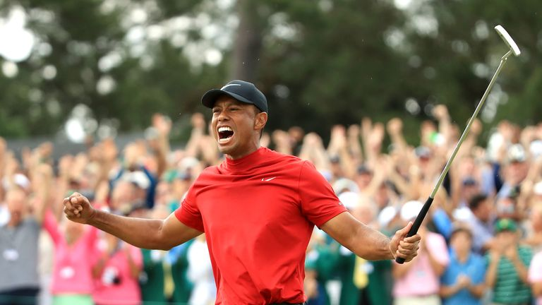 Woods earned his fifth Green Jacket and his 15th major, and his first since 2008