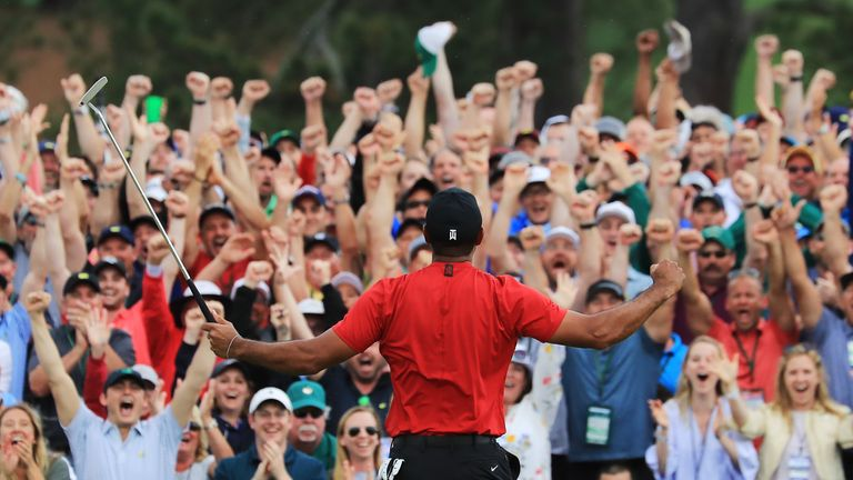 Tiger Woods celebrates in front of the crowd at Augusta after sinking his putt to win The Masters 2019