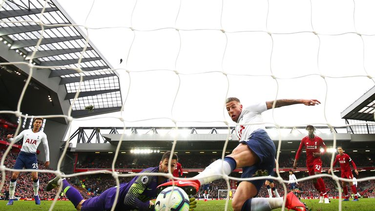Toby Alderweireld scores an own goal against Liverpool at Anfield