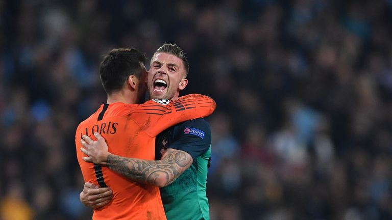 Toby Alderweireld and Hugo Lloris celebrate at the final whistle at the Etihad
