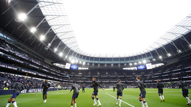Spurs players warm up ahead of the Premier League match against Huddersfield Town at Tottenham Hotspur Stadium