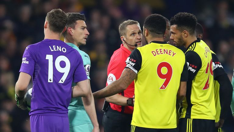 Troy Deeney of Watford remonstrates with Referee, Craig Pawson after being shown a red card for an elbow on Lucas Torreira of Arsenal during the Premier League match between Watford FC and Arsenal FC at Vicarage Road on April 15, 2019 in Watford, United Kingdom.