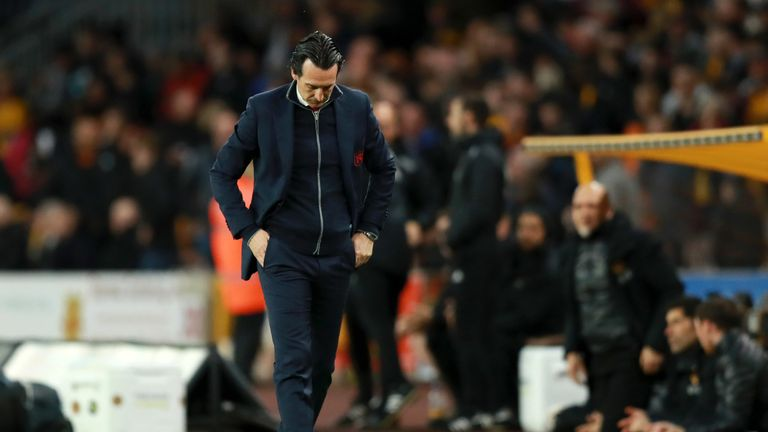 Unai Emery appears in contemplative mood as he walks along the touchline at Molineux