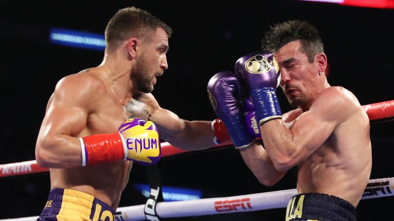 April 12, 2019; Los Angeles, CA;  WBO/WBA lightweight champion Vasiliy Lomachenko and Anthony Crolla during their lightweight title bout at the Staples Center in Los Angeles, CA.  Mandatory Credit: Ed Mulholland/Matchroom Boxing