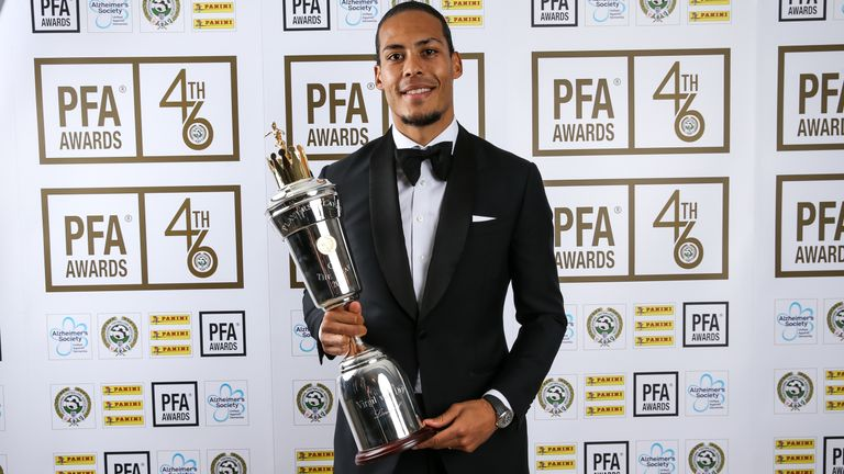 Virgil van Dijk proudly shows off his PFA Player of the Year award