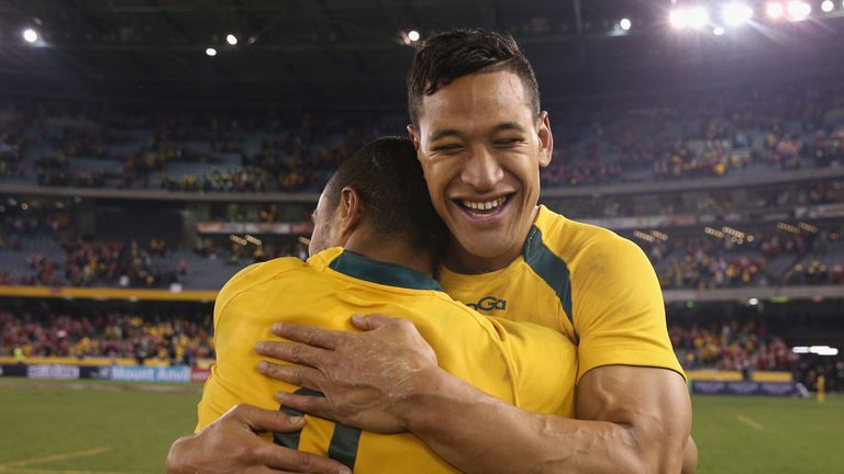 Will Genia and Israel Folau embrace after beating the British & Irish Lions in Melbourne in June, 2013