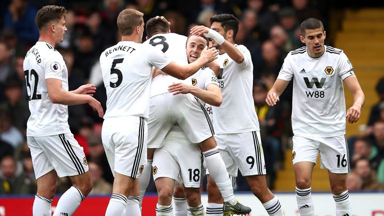 Diogo Jota of Wolverhampton Wanderers celebrates with teammates after scoring his team's second goal during the Premier League match between Watford FC and Wolverhampton Wanderers at Vicarage Road on April 27, 2019 in Watford, United Kingdom.