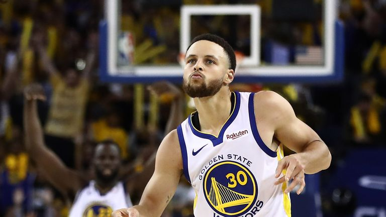 Stephen Curry shimmies in celebration after making a three-pointer
