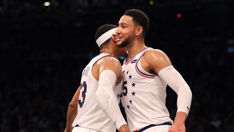 Tobias Harris and Ben Simmons share a chest-bump during the 76ers' Game 2 win over Brooklyn