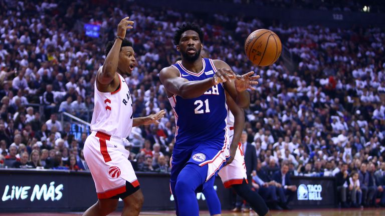 Joel Embiid throws a pass in Game 2 against the Raptors