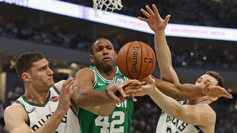 Al Horford is smothered by the Milwaukee Bucks defense in Game 2