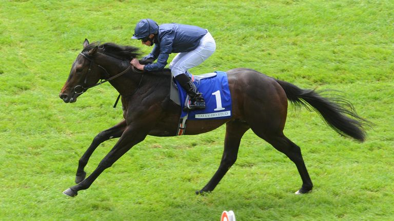 Arizona and Ryan Moore win the Tally Ho Stud Irish EBF Maiden during day two of the Curragh Spring Festival