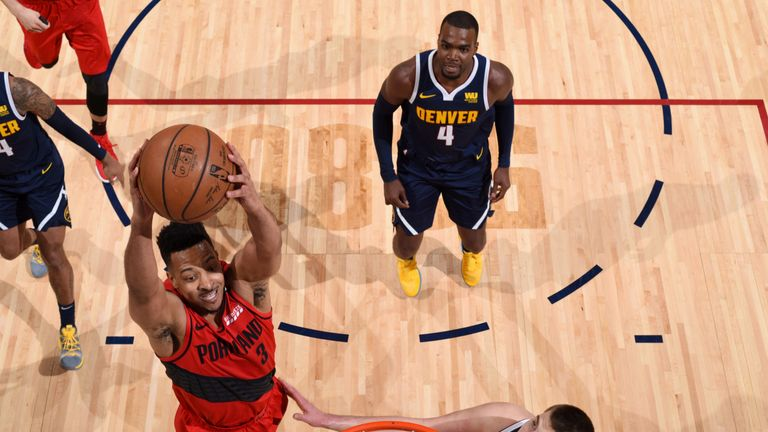 CJ McCollum soars for a dunk in Game 7 against the Nuggets