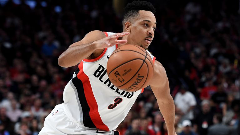 Blazers guard CJ McCollum goes on the attack against Denver in Game 6