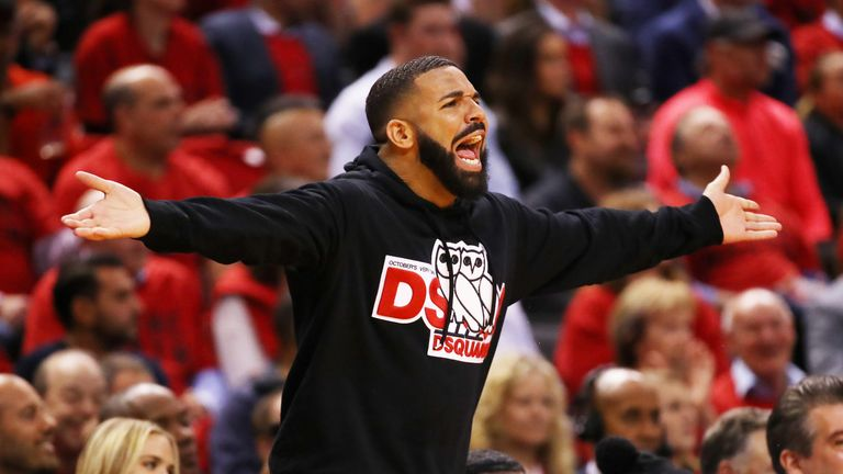 Drake gestures from the sidelines during the Raptors' Game 4 over the Bucks