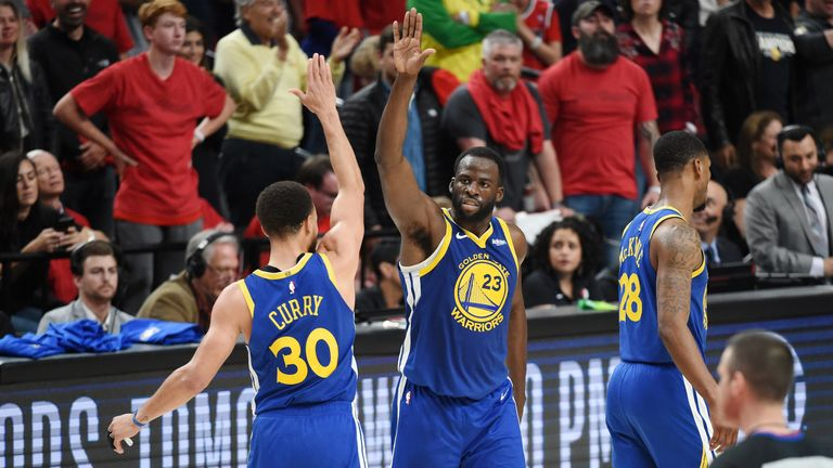 Draymond Green high-fives team-mate Stephen Curry during Game 4 of the Western Conference Finals