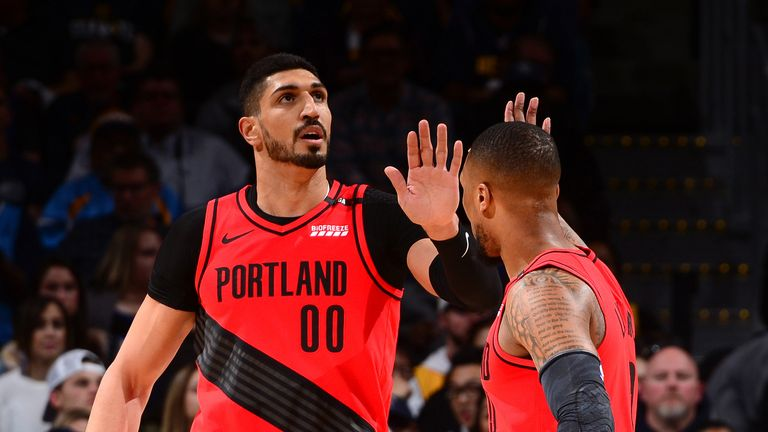 Enes Kanter celebrates a basket with team-mate Damian Lillard
