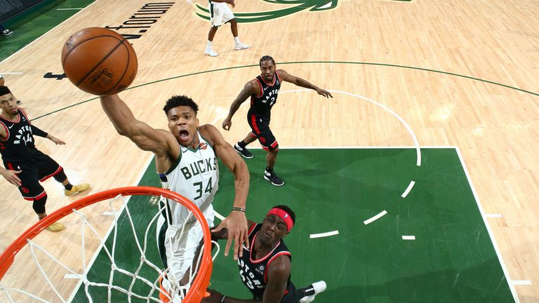 Giannis Antetokounmpo soars for a huge dunk against the Toronto Raptors in Game 2 of the Eastern Conference Finals.